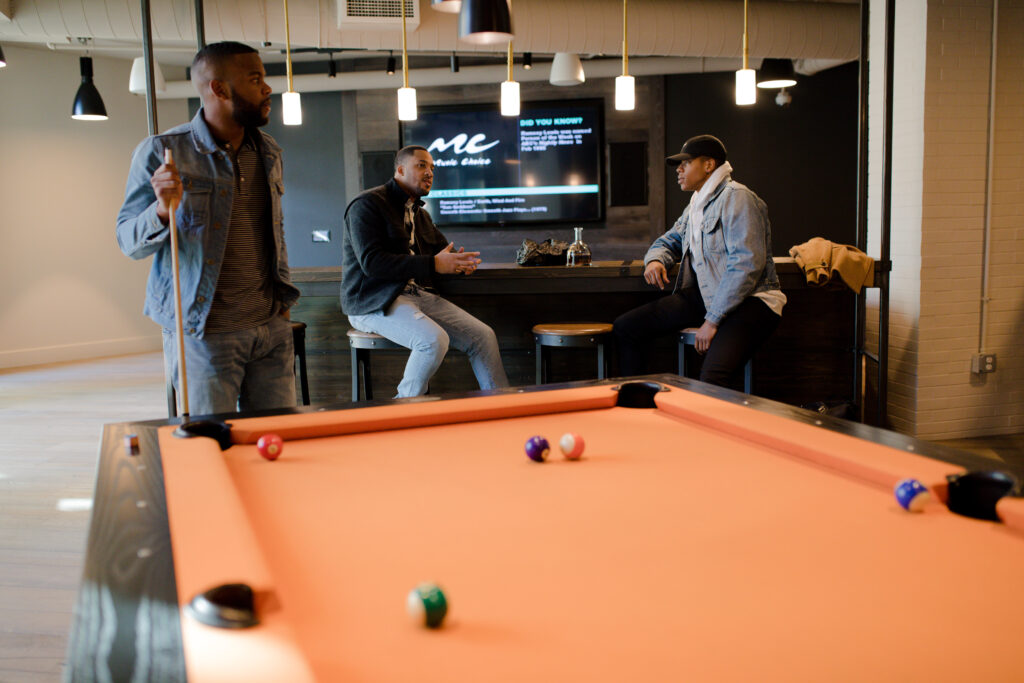 Friends playing a game of billiards