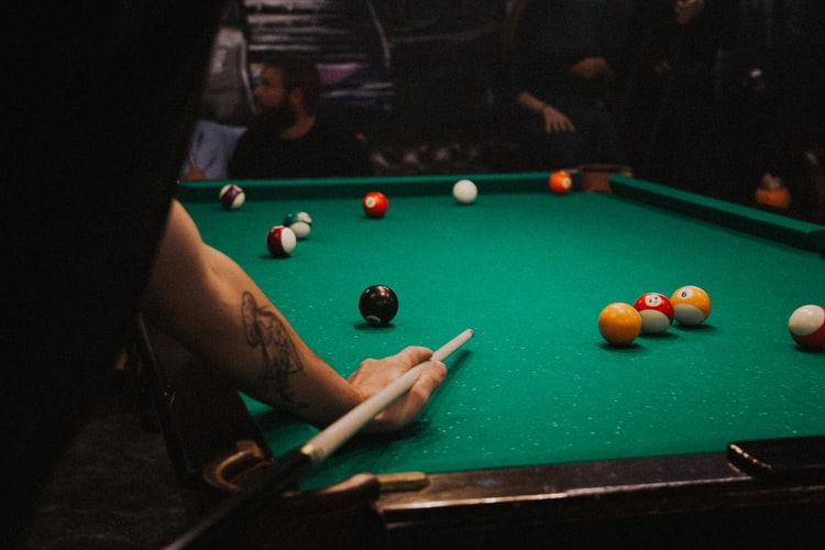 Person playing pool by himself