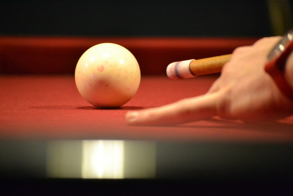Close up of a pool ball made out of polyester being used in a game