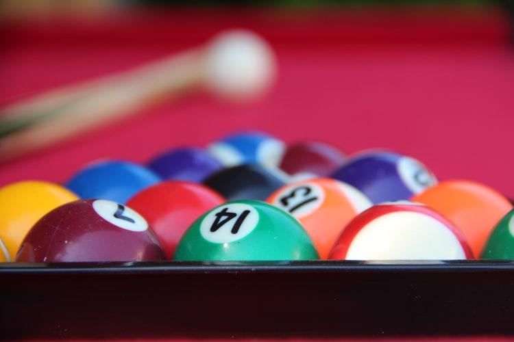 Clean billiard balls inside a rack