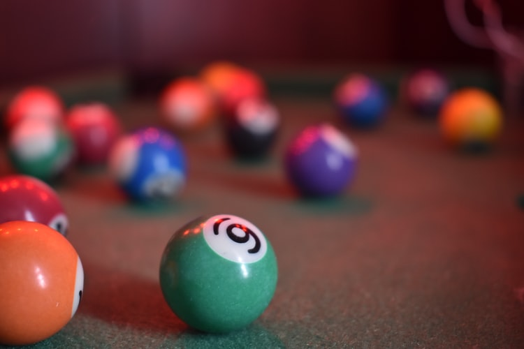 pool balls dispersed on a pool table