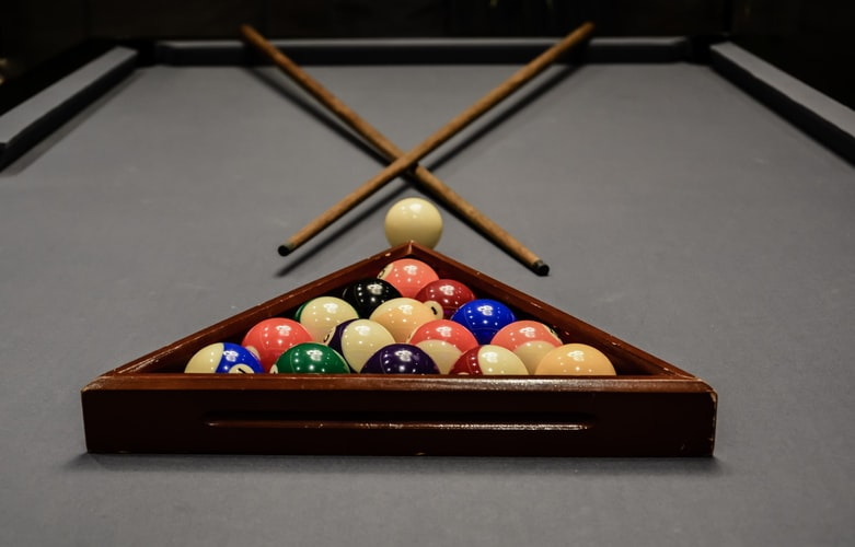 Pool balls placed inside a rack