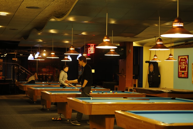 People playing pool in a game center