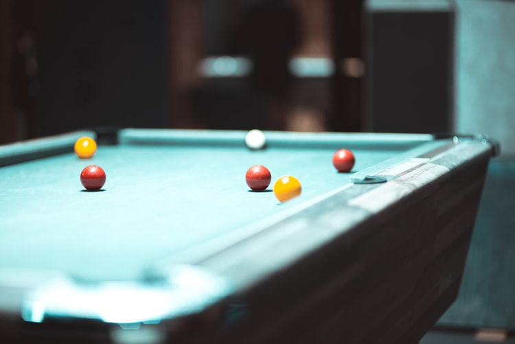 Close up of a pool table with balls