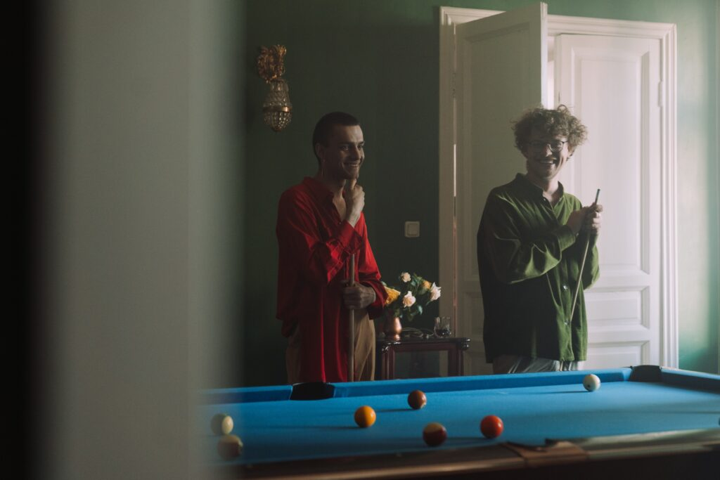 People playing a game of pool