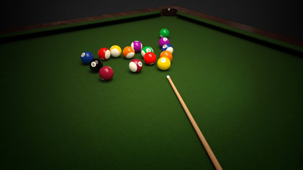 A set of billiard balls and a cue stick