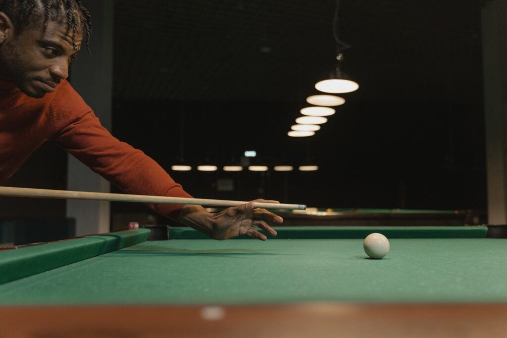 Man using the best low deflection shaft while playing pool