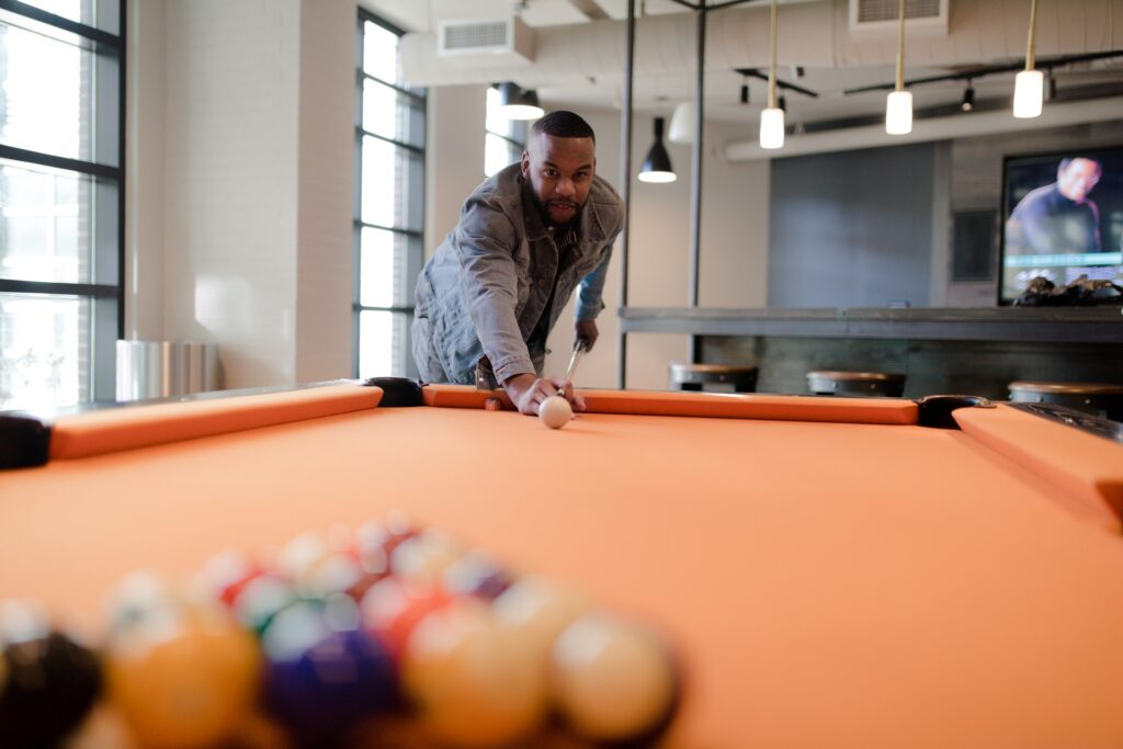 Man ready to hit the cue ball