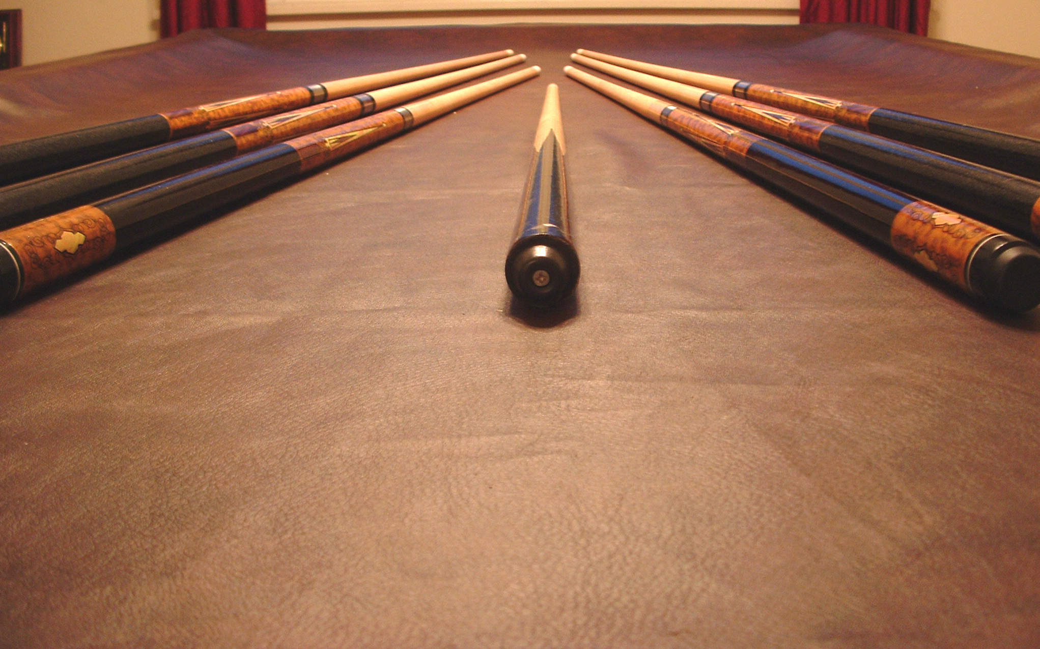 Various pool cue in need of straightening