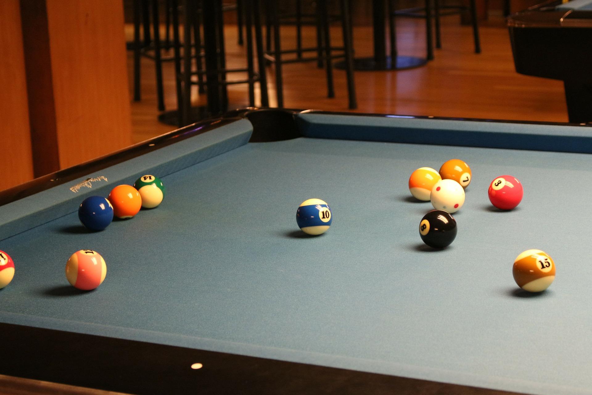 Pool balls on a budget pool table