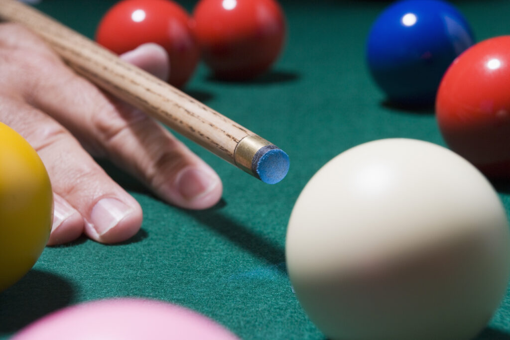 Person using a pool cue for intermediate player