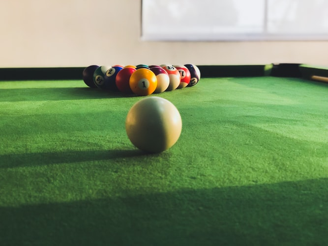 Balls on a pool table cushions