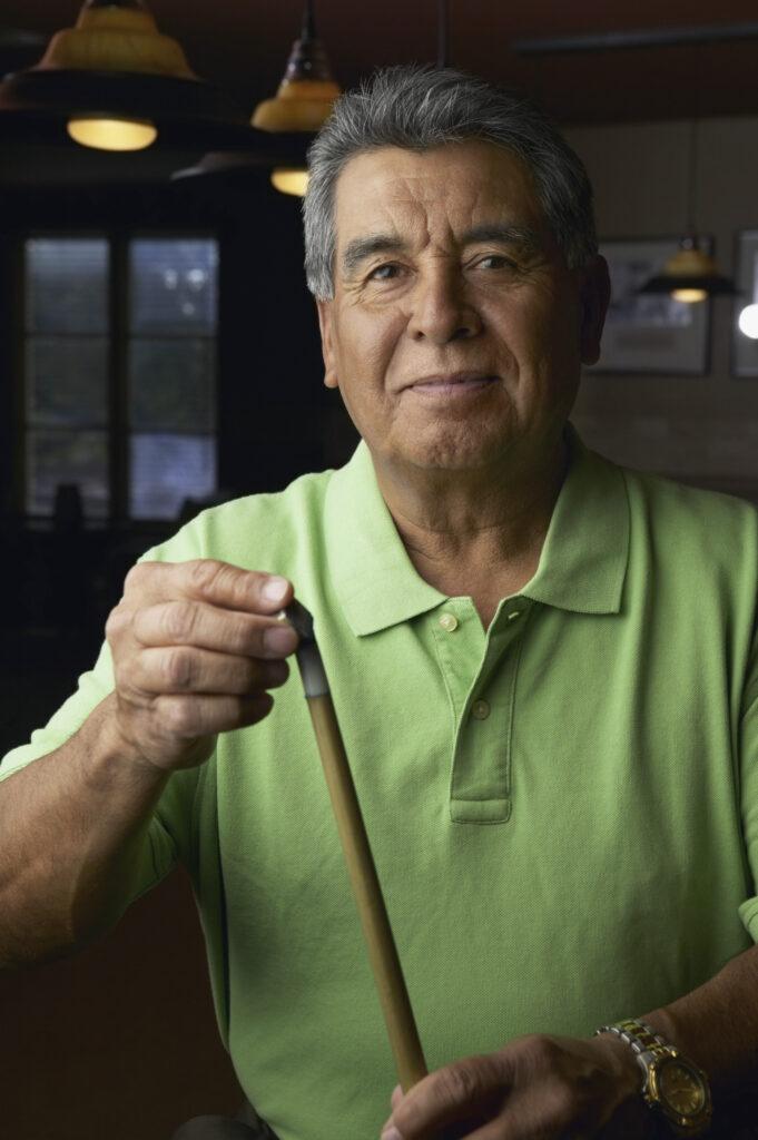 Man using a cue tip shaper