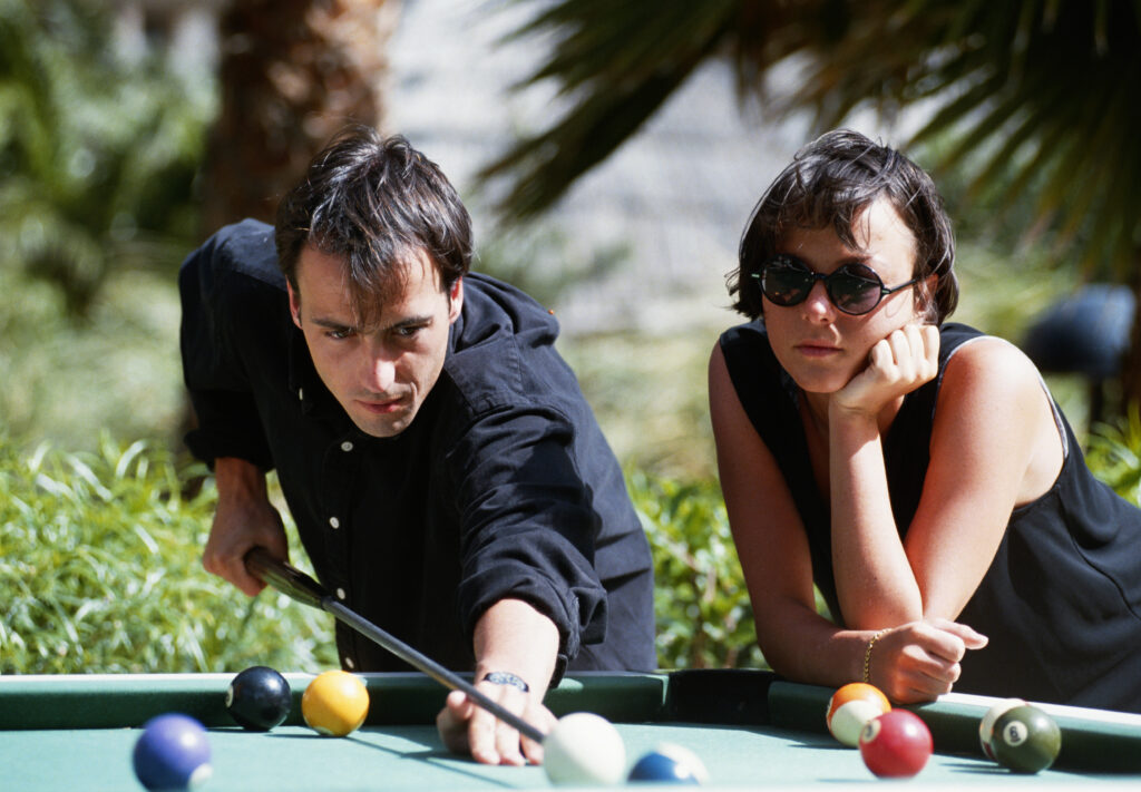 Couple playing on an outdoor pool table