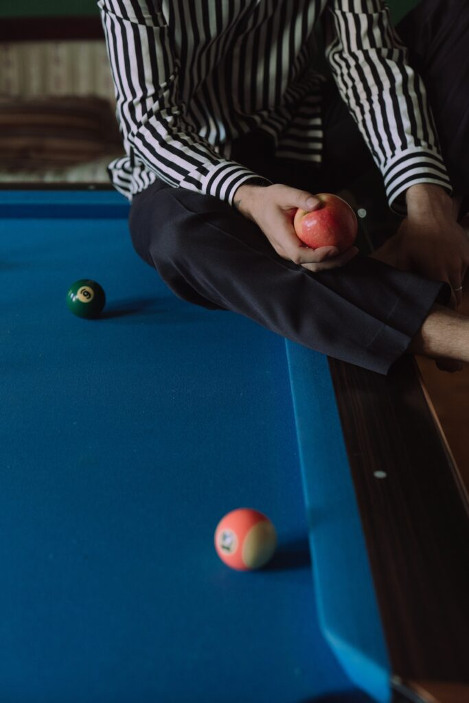 Man sitting at a pool table