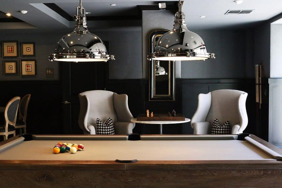 Billiards table with cue balls on top