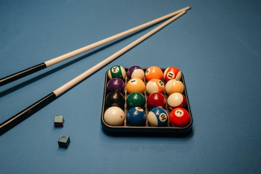 Pool cue sticks with ball set and chalk