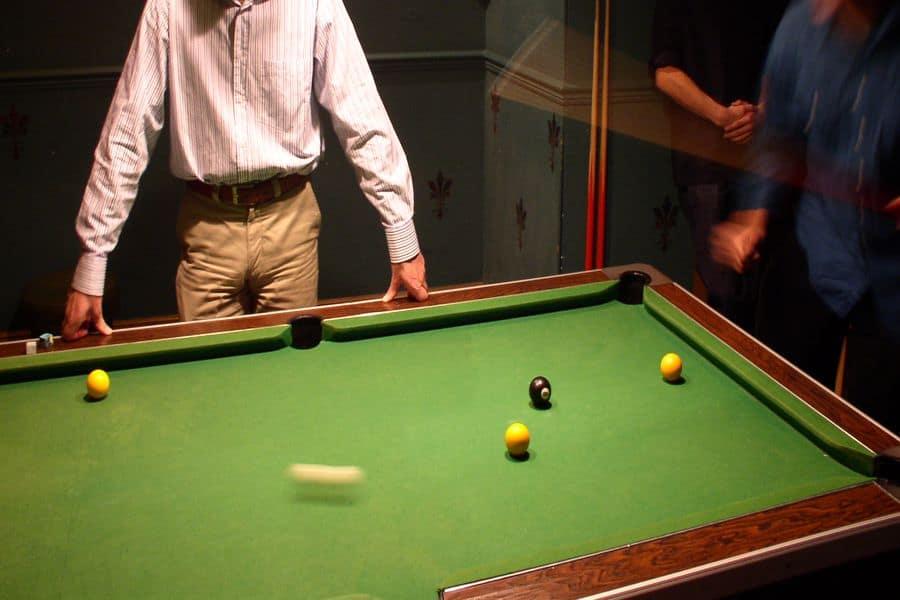 Man measuring a pool table