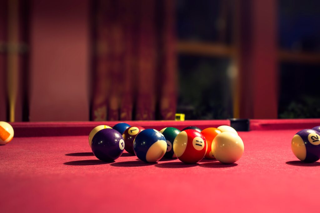 Playing pool with a red table felt cloth