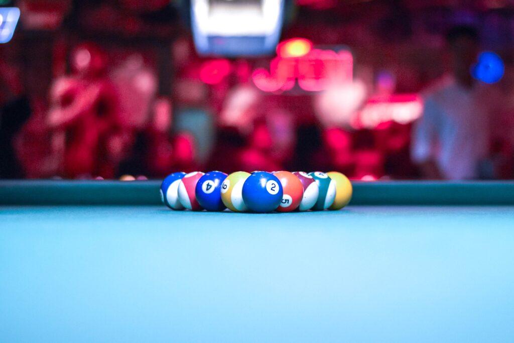 A pool rack with blue table felt cloth