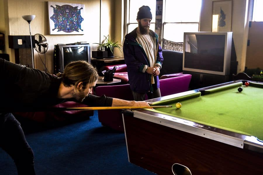 Guys playing a snooker game