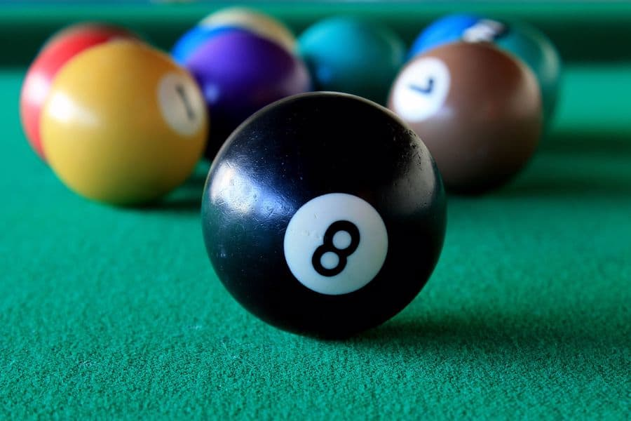 Cue balls on a pool table