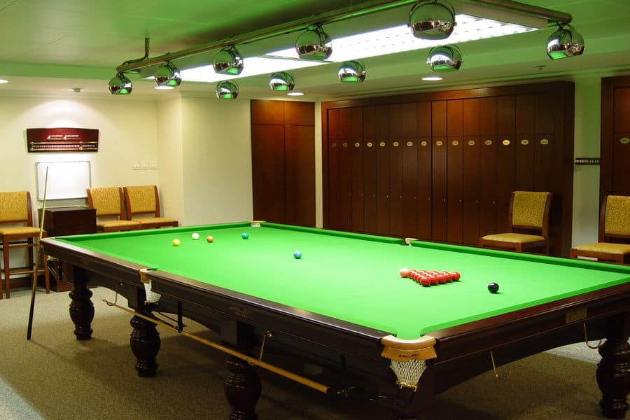 Snooker table with cue balls on top